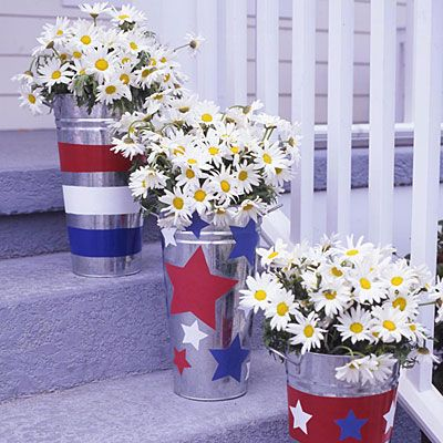 Arrange buckets of pretty daisies