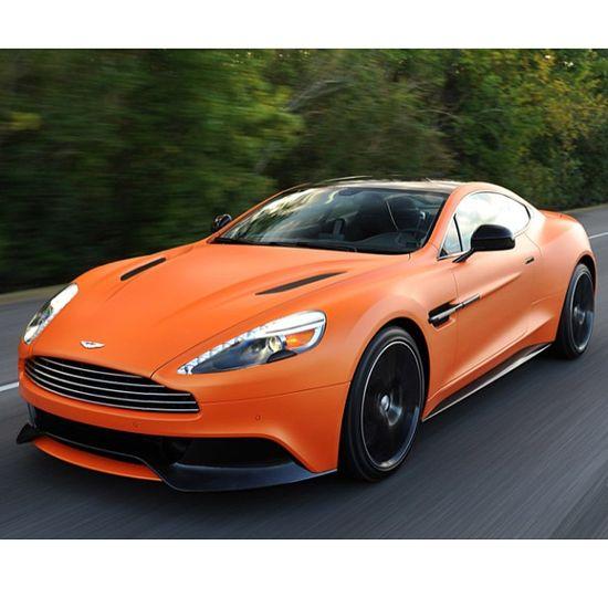 Matte Orange Aston Martin with Black wheels.