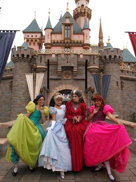 Cinderella and family in front of Sleeping Beauty Castle in Disneyland
