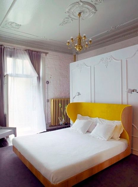 Beautiful classic ceiling, wall design with a fun colorful bed and chandelier design...