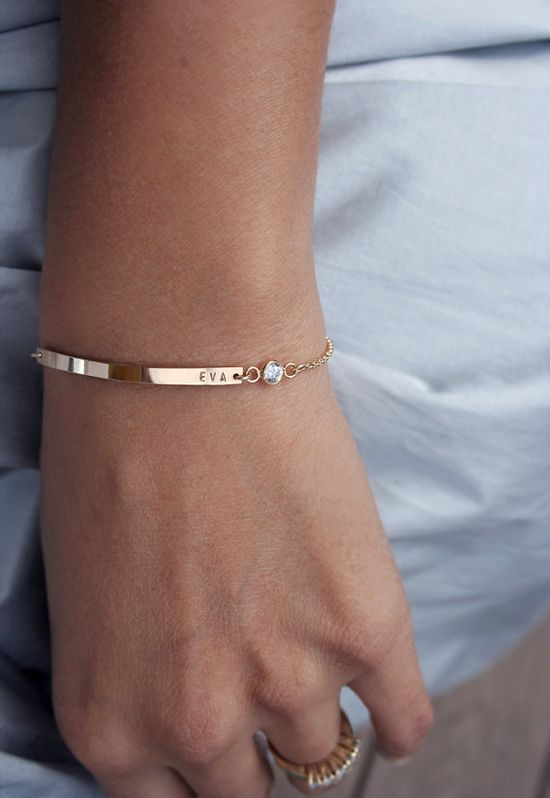 Smitten with the idea of wearing two or three of these slim bracelets at the same time. Maybe with each kids name and birthstone.