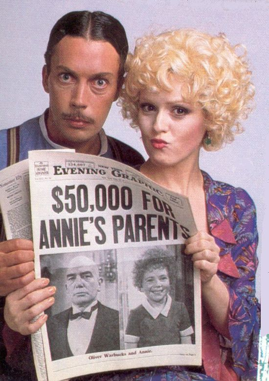 Tim Curry and Bernadette Peters as Rooster Hannigan and Lily St. Regis in Annie (1982)