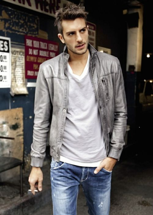 layered white & grey tee, grey leather jacket, blue jeans / men fashion