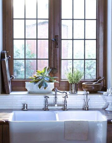 Bib front sink, miniature subway tiles, wide window sill, Outward opening paned windows...