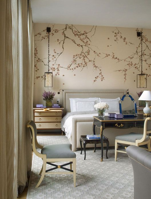 A desk at the foot of the bed, the hanging lanterns, the gorgeous wallpaper behind the upholstered bed... so fabulous!