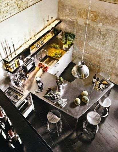 Industrial Loft Kitchen with Exposed Brick Wall