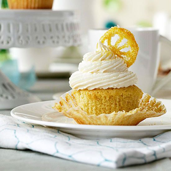 These Lemon Drop Cupcakes are bursting with lemon flavor! More cupcake recipes: www.bhg.com/...