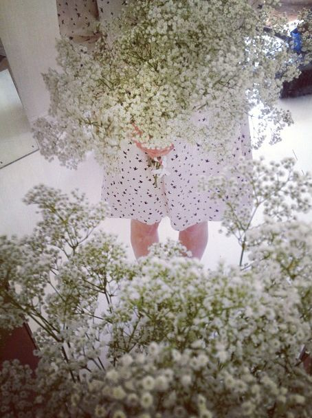 Flower arranging in Samuji swallow print dress