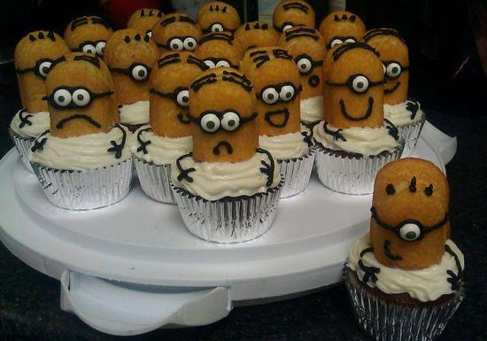 Twinkies sliced, atop cupcakes with a bit of creative frosting = minions!