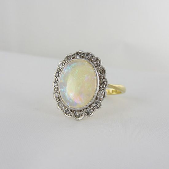 Art Deco Opal Ring. Antique Ring with Diamond Halo, 1930s.