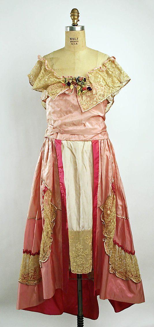 Pink silk evening dress with cotton lace trim and silk flowers, by Lucile, British, ca. 1916.