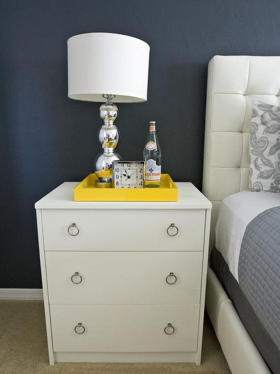 Use a serving tray to keep small items neatly corralled on a nightstand. www.hgtv.com/...