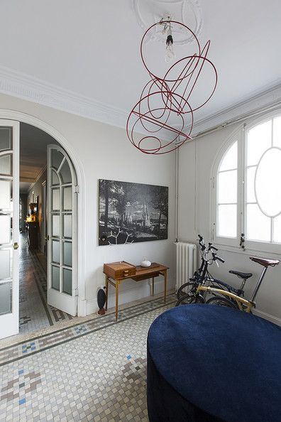 Arched french doors with frosted glass panels.  Interior design by Georg Kayser