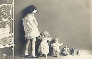 vintage photo little girl with dolls