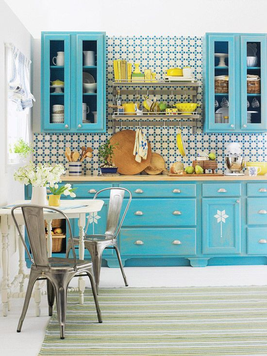 Totally me less the busy tile work. Country Cabinets  Go country chic with distressed cabinets. Paint wood cabinets in your choice of color (a bolder hue, such as this vibrant robin?s egg blue, will lend a more modern look) and once dry, do a little bit of sanding around the door edges and across the cabinet fronts.