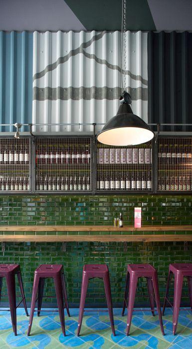 Jamie's Italian. Green tile. Mosaic floor. Pink stools. Funky Industrial interior restaurant design
