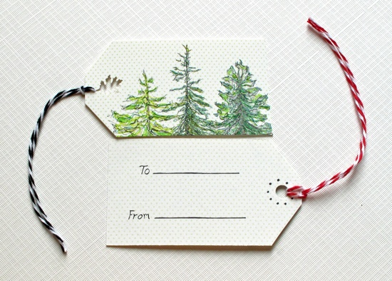 Pretty tags adorned with evergreens.