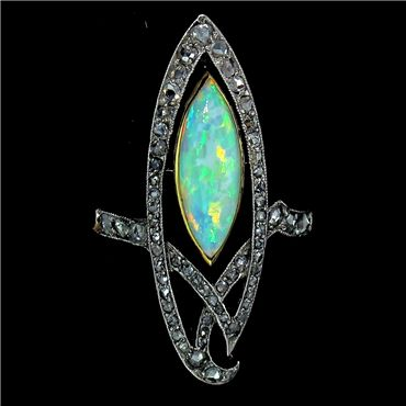 Art Nouveau. Chevron style ring c 1900 features a marquise opal surrounded by diamonds, set in platinum and gold