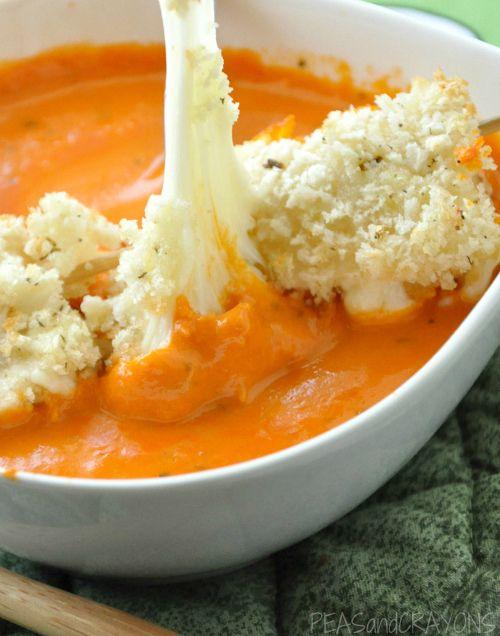 Creamy tomato soup with baked mozzarella balls.