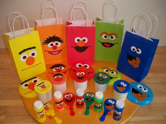 Sesame Street party favor ideas - goldfish crackers for Dorothy/Elmo, reusable bag for Oscar, cookies for Cookie Monster, rubber duckie for Ernie.    Need idea for Big Bird and/or Burt