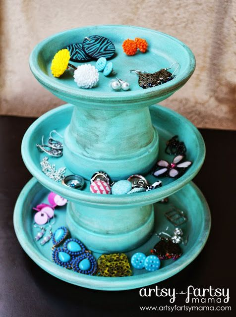 DIY Jewelry Stand:  miniature terracotta pots and saucers.  Not sure about the patchy paint but like the idea.