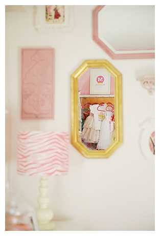 loving the gold mirror in this pretty pink bedroom