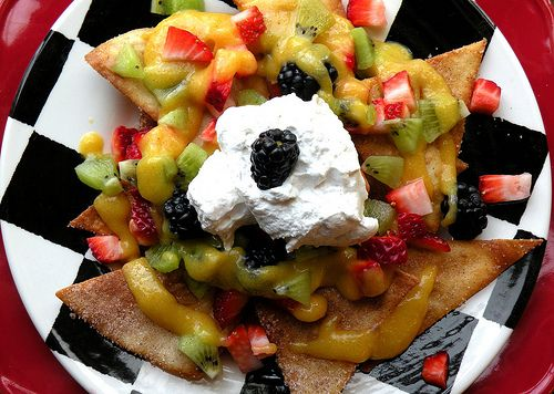 Dessert Nachos: Cinnamon sugar chips topped with diced fruit, mango puree, and whipped cream. Perfect for Cinco de Mayo food and parties!
