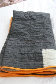 """This would be cool to do to old quilts that are falling apart.  Buy 2 flat sheets the size of the quilt and sew them around the old quilt using uneven, zig-zaggy lines.  Maybe Kaity could even do it.  Then sew the edges together with seam binding tape.  Hmmm.  DIY The """"24 Hour"""" quilt. Just take two (or one) solid color fabrics and sew zig-zag lines."""