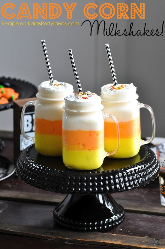 Candy Corn Milkshakes! Perfect for a Halloween Party! Recipe on KarasPartyIdeas.com #candycorn #desserts #candycornmilkshakes #halloweenpart...
