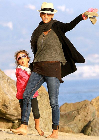 Halle Berry frolicking on the beach with daughter Nahla in Malibu Dec. 9 2012.