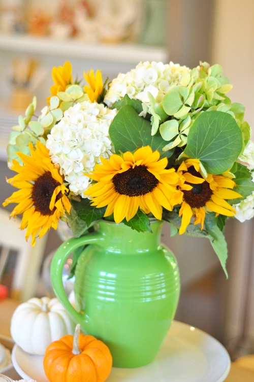 love the flower arrangement in the pitcher