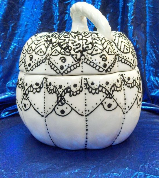 Ceramic pumpkin with puffy paint; I combined Zentangle inspired artwork and henna tattoo patterns for this one.