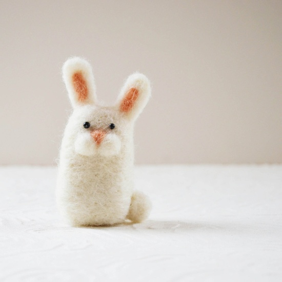 A soft and wooly needle felted bunny.
