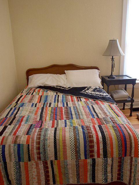 scrappy strip-pieced quilt by fancytiger, via Flickr