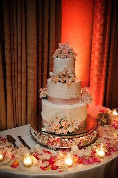 Tiered wedding cake with light pink flowers