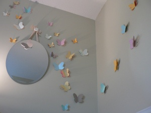 butterflies on wall from scrapbook paper using double sided tape - another shape?