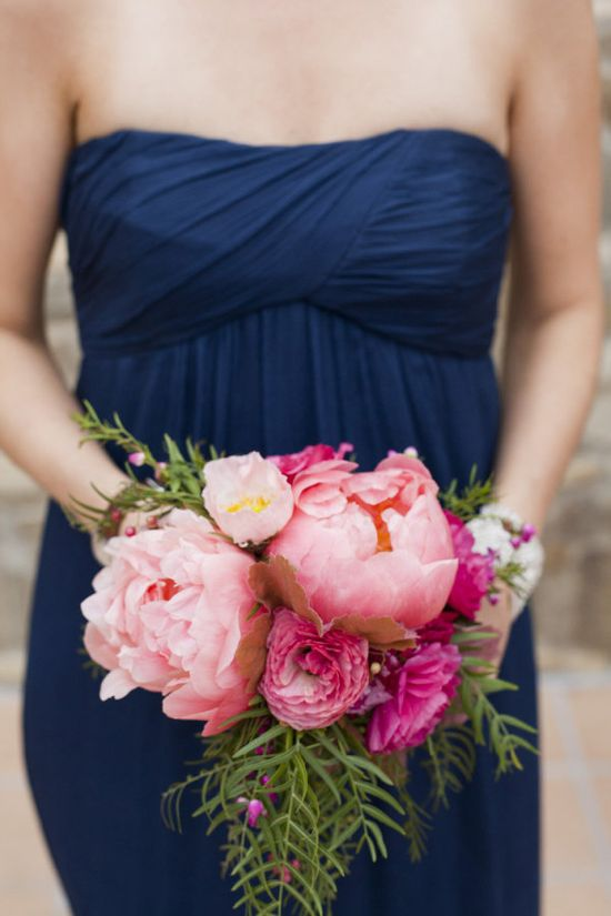 Navy bridesmaid dresses with big peonies in vivid pinks