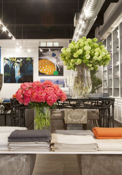 Dramatic vases of flowers in a retail environment