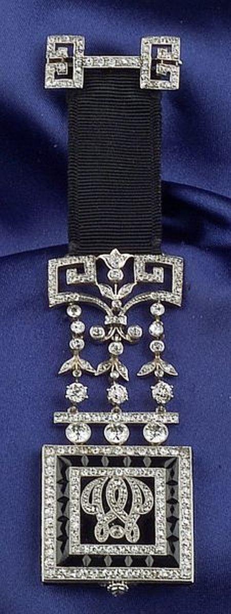 Art Deco Onyx and Diamond Pendant Watch, Cartier