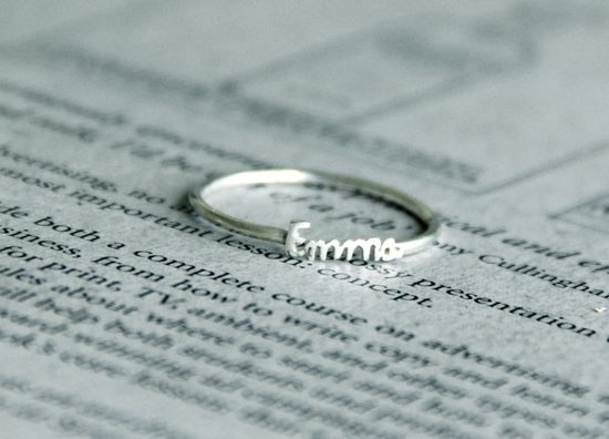 35 dollars and you can choose any words to be put on the ring, in whatever font you like.