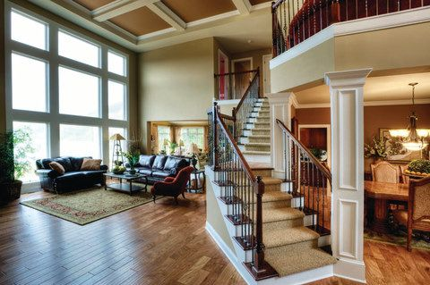 Love so many of the details in this family room. The windows are FAB, as is the ceiling. Love the staircase and wood floor, love how open the room is. In other words...this room would make me very happy :)