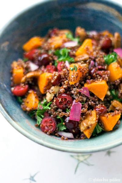 Red quinoa salad with pumpkin, dried cranberries and pecans