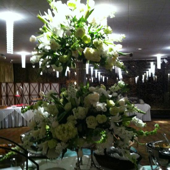 Wedding flower arrangement on food table.
