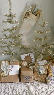 sweet and simple  Use my small tinsel tree.  Need to gift wrap boxes in brown kraft paper