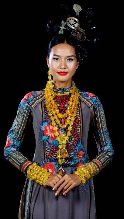 Ao dai - not wedding-related but I love the hill-tribe design. And the hair is kind of cool too.
