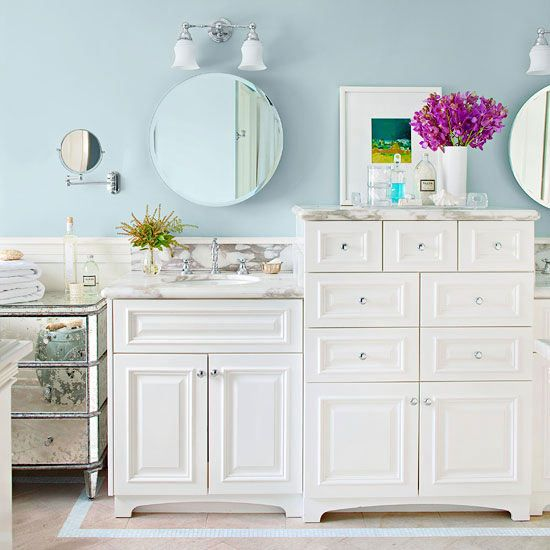 Stacked drawers add smart storage to this cottage-style bath. More ideas for bathroom decor: www.bhg.com/...