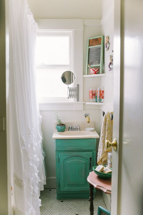 The green vanity makes this tiny bathroom in Oakland, California, bright and happy. See the full home here at Sneak Peek: Rebekah Carey McNall of A & B Creative. #sneakpeek