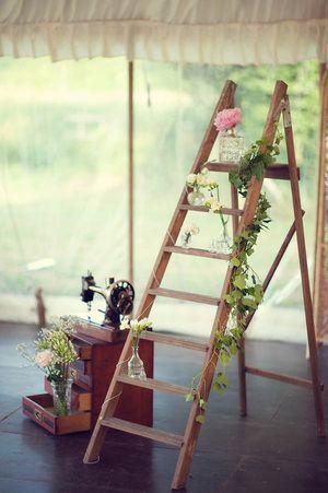 A great & simple decor idea - use a ladder as a shelf display! #DIY #budget #wedding #reception