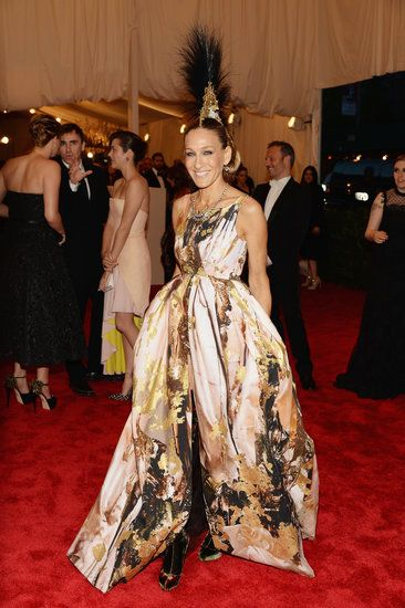 Sarah Jessica Parker stunned at the Met Gala in a Giles Deacon gown, a Philip Treacy headdress, and plaid Louboutin boots!