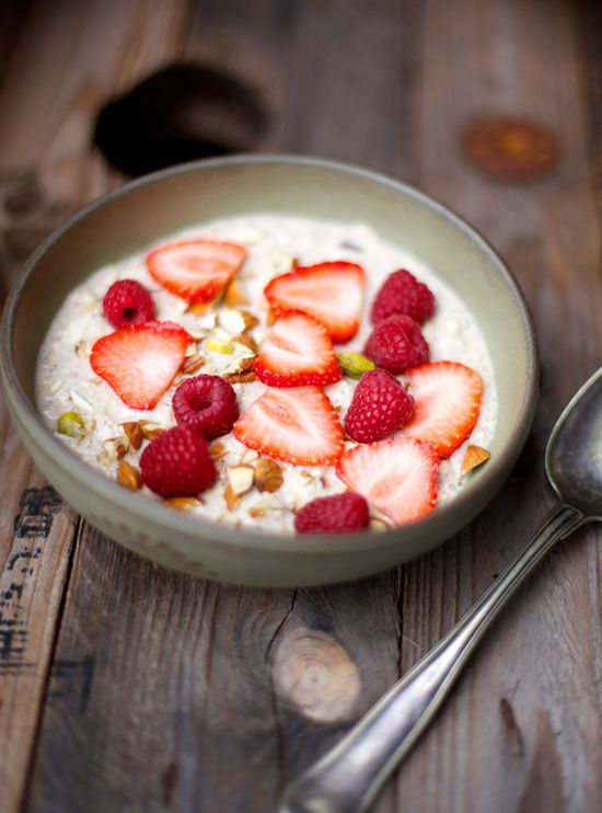 {Oatmeal porridge with almonds, vanilla, strawberries and dates.}